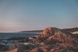 rocky formations near rippling ocean water